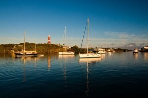 abaco lighthouse and the harbor with boats