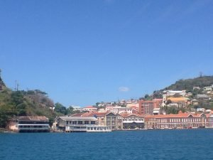 coastline of island with houses and buildings