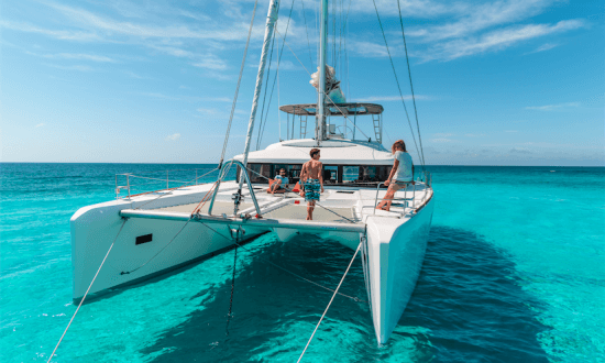people enjoying a crewed charter on turquoise waters