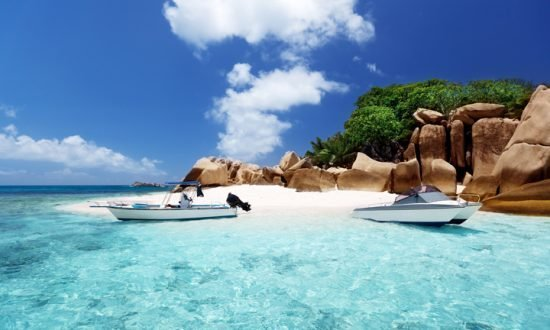 boats on the rocky beach on Seychelles