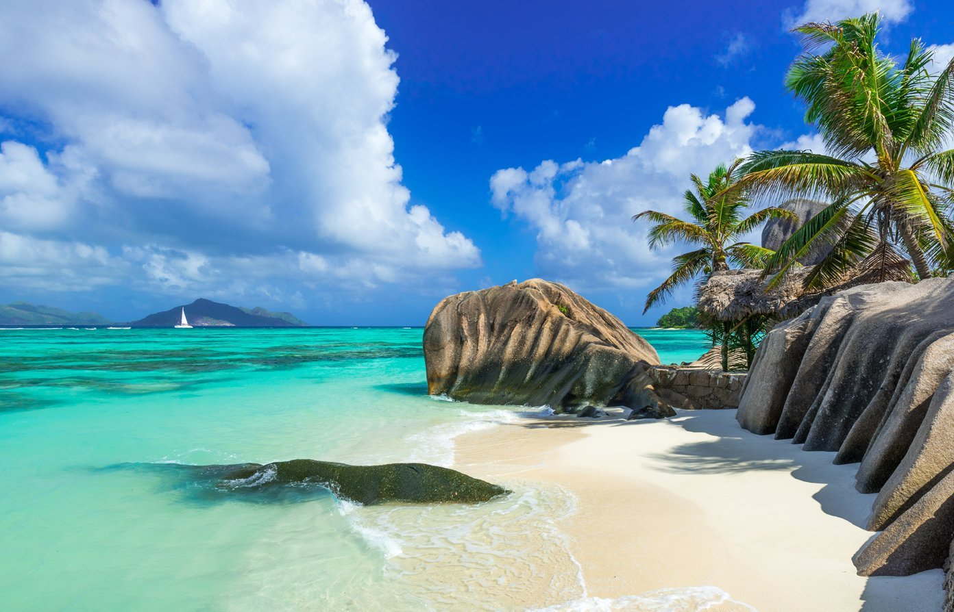 Seychelles beach with rocks and palm trees