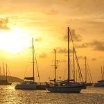 boats anchored during sunset in St Martin