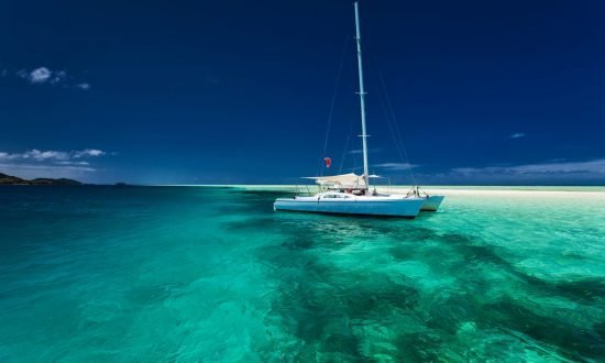 boat on the blue water near beach