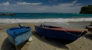 boats on the beach with waves crashing in