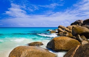 waves crashing on rocks in seychelles