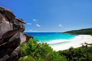 white beach with waves crashing in Seychelles