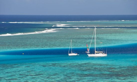 boats in the blue water of Seychelles