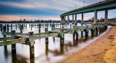 Chesapeake Bay docks and bridge by beach