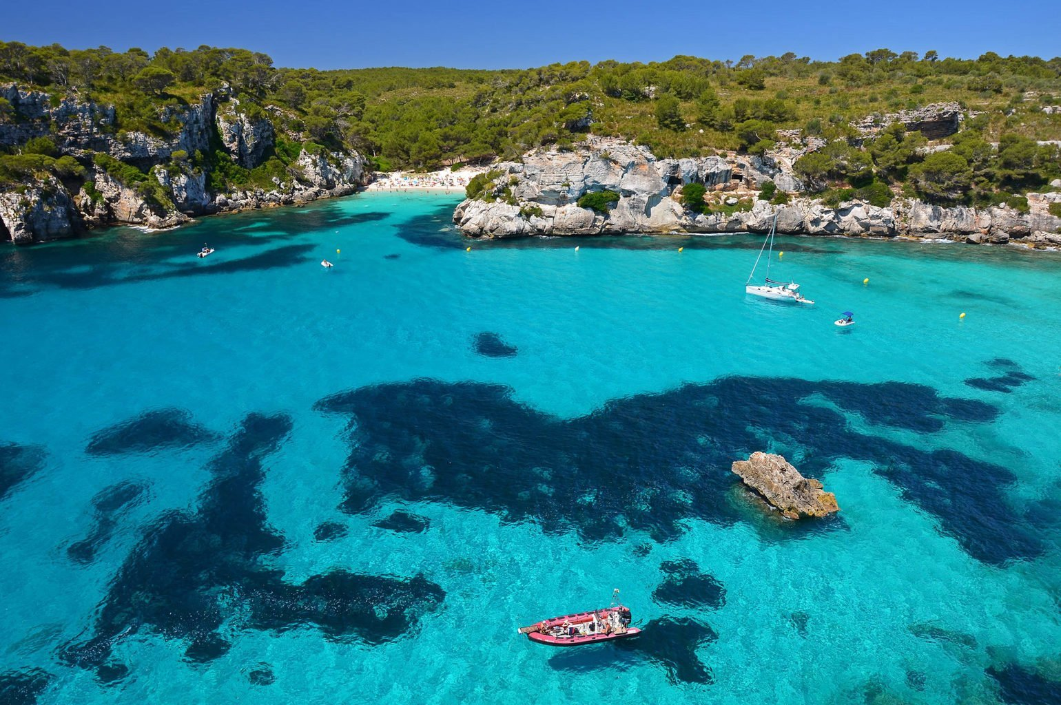 boats and hidden beach in the Balearic Islands