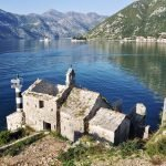 old church on the edge of the water