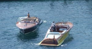 wooden boats passing eachother