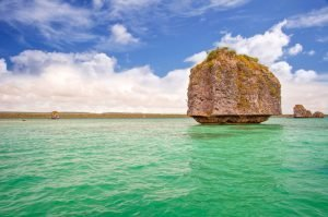 large rock island in the waters of New caledonia