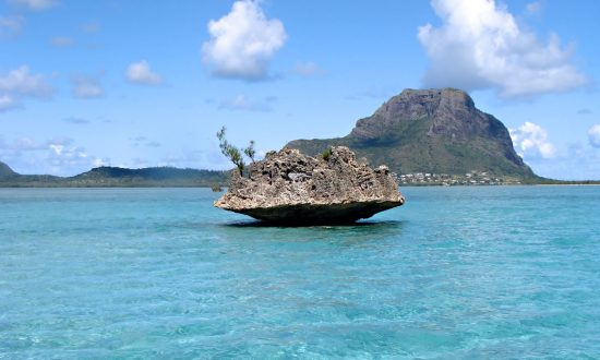 rock formation in the middle of the water