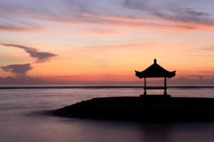 hut in bali at the edge of water