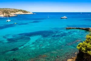 blue water and boats in the balearic islands