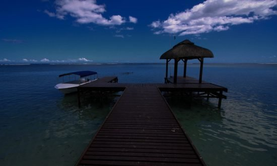 Mauritius dock with boat and hut