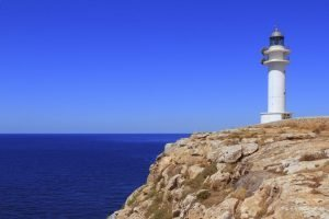 lighthouse and rocks on the balearic islands