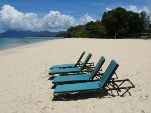 lawn chairs on the beach