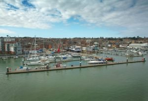 boats docked at the edge of hamble