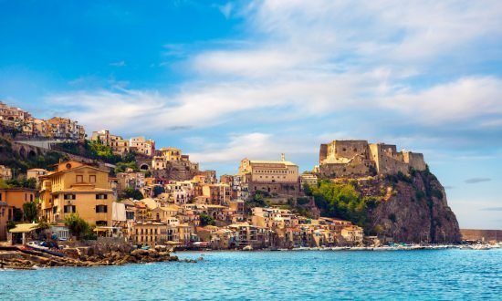 houses and stores along the coast of a sicily town