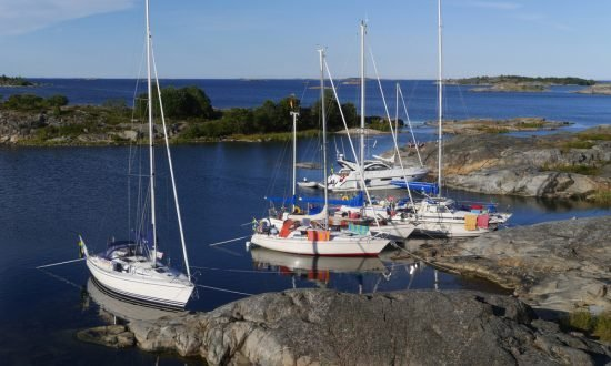 boats anchored at the rocky edge of stockholm island
