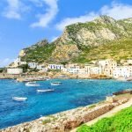 town of sicily rocky edge with boats in the harbor