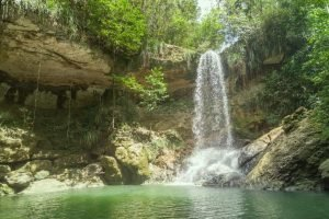 Waterfall in the rocks of Puerto Rico