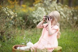 photo of child with camera