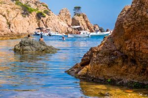 swimming and boats in the water of Spain