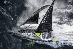 Alex Thomson racing his boat through the waters