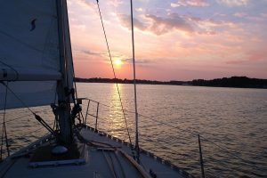 Boat sailing in the water of Chesapeake Bay during sunset
