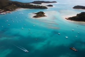 Aerial View of boats headed towards Airlie Beach