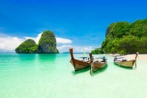 traditional boats in the shallow water off Thailand