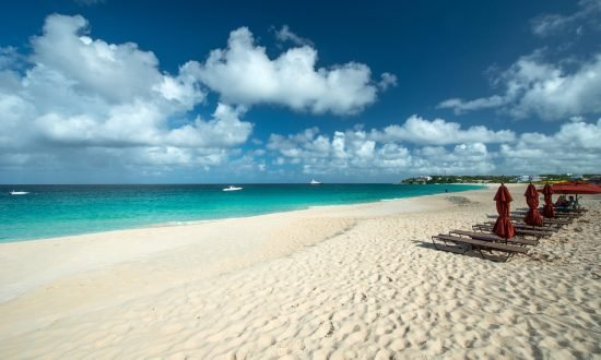 lounge chairs and umbrellas on the beach of Meads Bay Anguilla