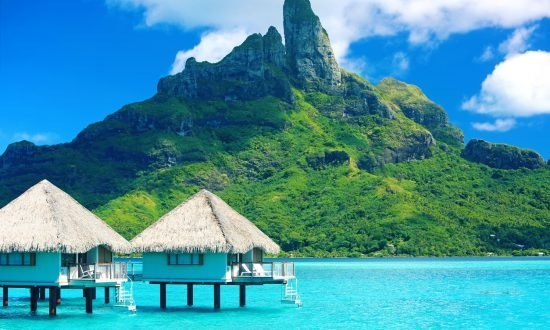 bungalows in the water next to mount otemanu tahiti