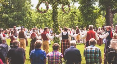 Dancing around the maypole at Midsummer
