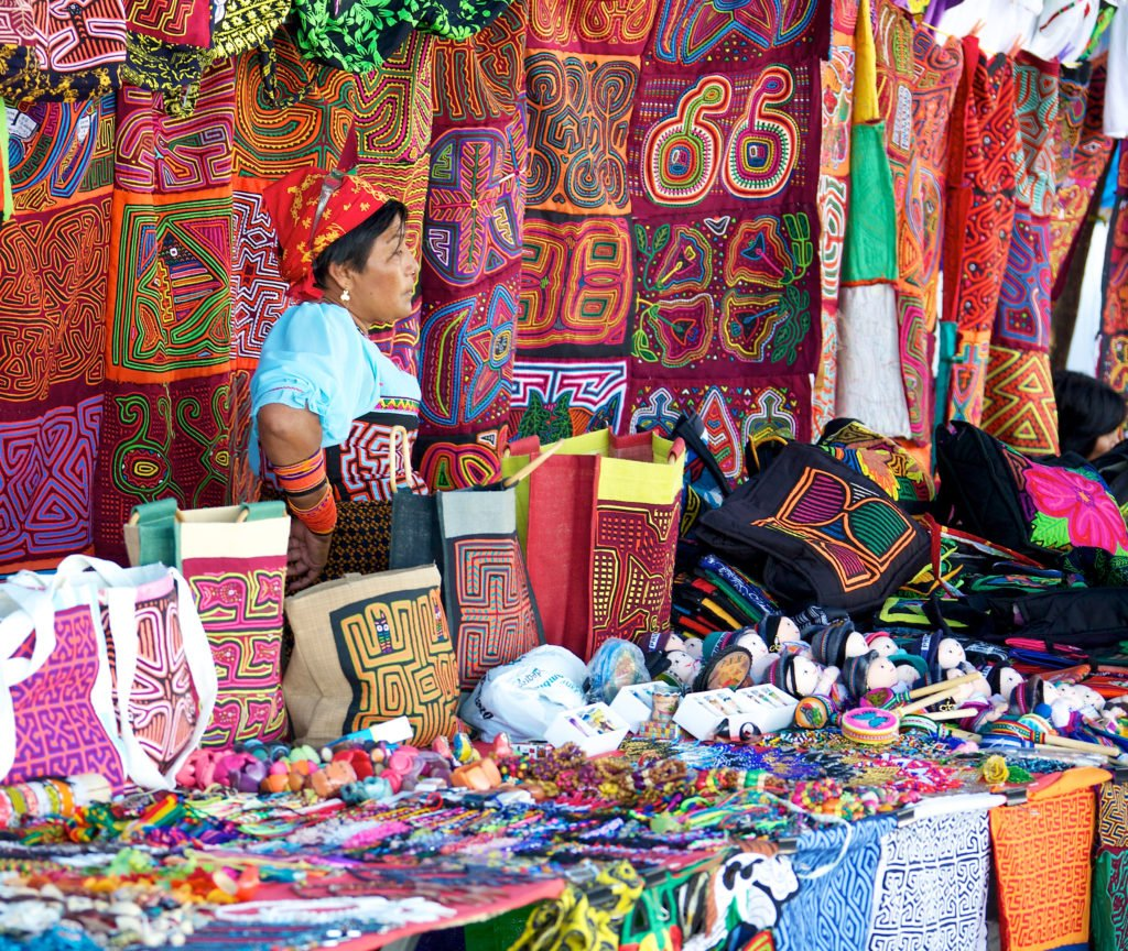 Kuna woman selling molas in an open air market