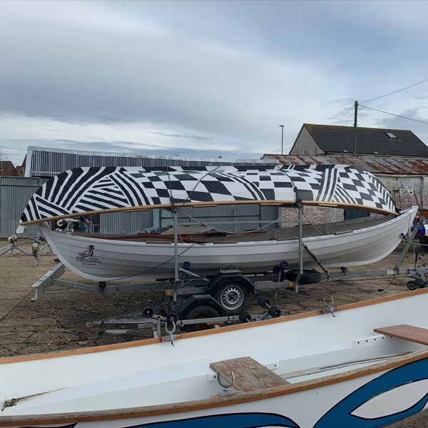 Skiff in yard at Oarsome Chance