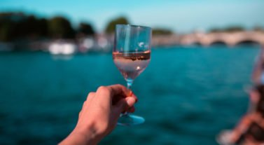toasting with a glass on a wine tasting cruise