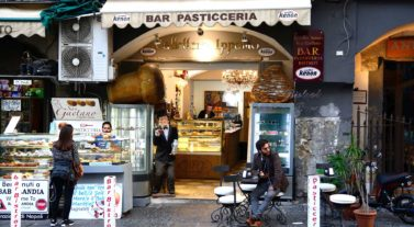 people drinking coffee in Italy at bar cafe