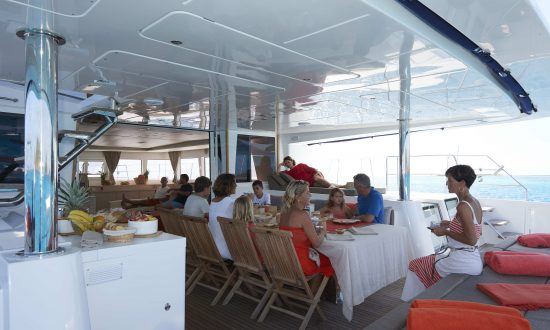 guests at dining table onboard yacht