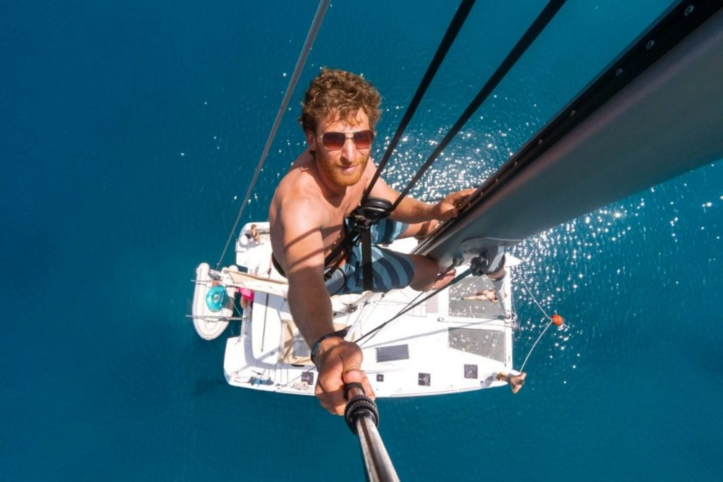 man at top of mast