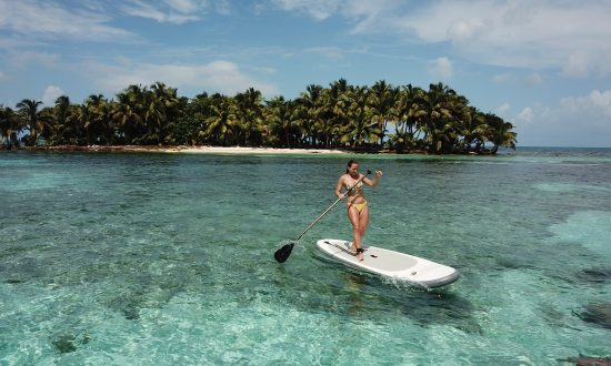 Woman paddleboarding in Belize