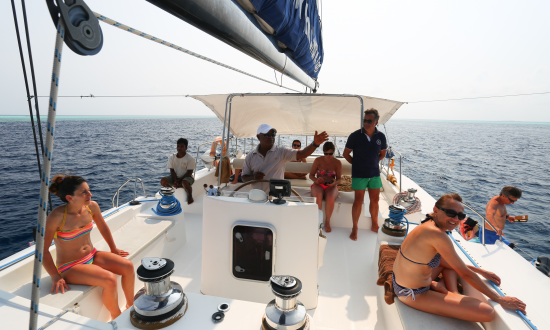 Skipper and guests on yacht