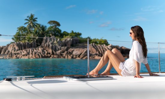 Woman sitting on yacht deck