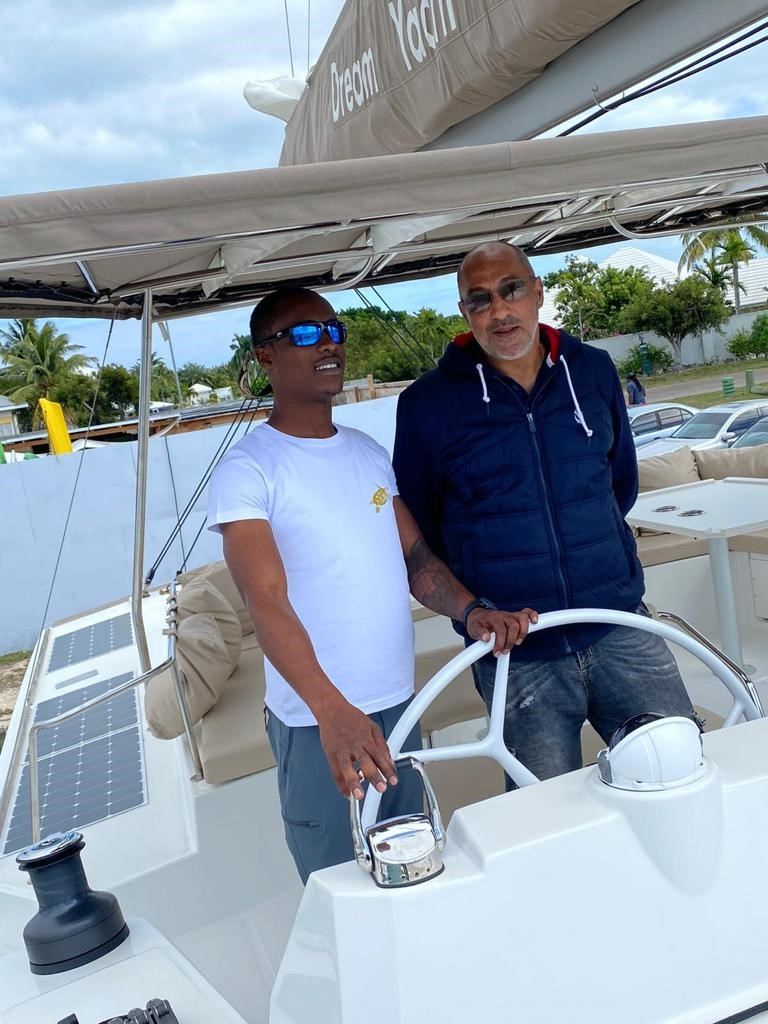 Intern at helm of yacht